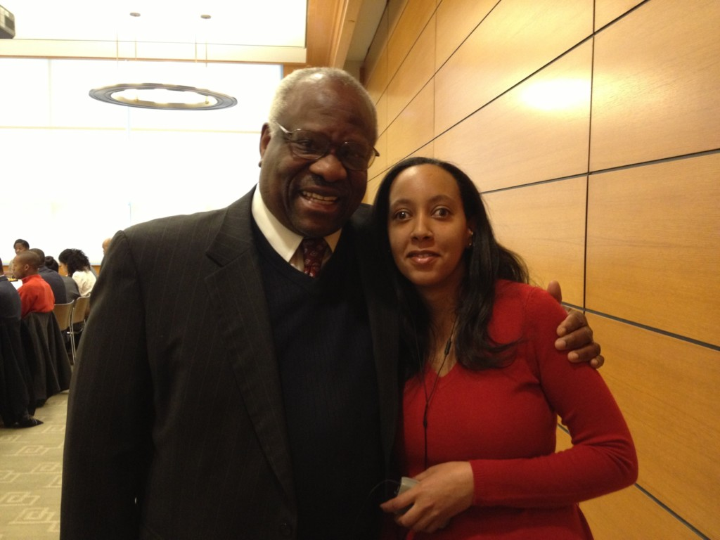 Supreme Court Justice Clarence Thomas and Haben Girma posing together at Harvard Law School.