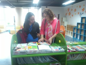 Haben and Tai read braille books at Library for the Blind