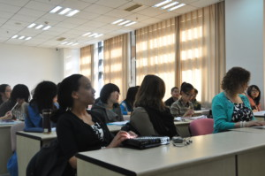 Haben and Tai sit in classroom at Renmin University School of Law