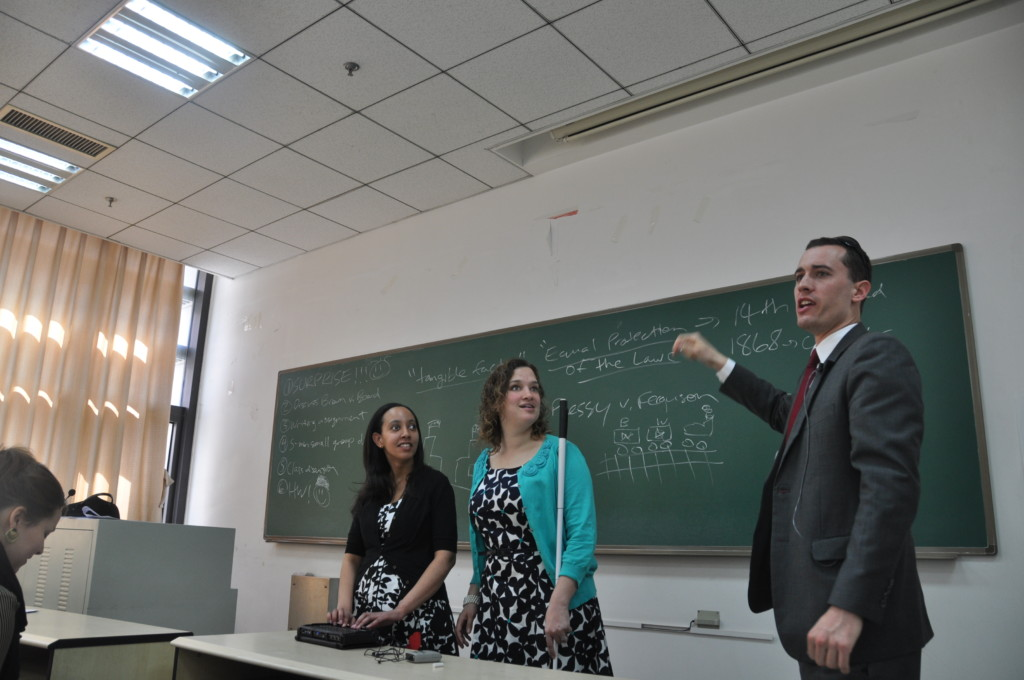 Prof. Charles Wharton introduces Haben and Tai to his class
