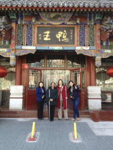 Haben, Tai, Xu Fei, and Xie Piao in front of roast duck restaurant