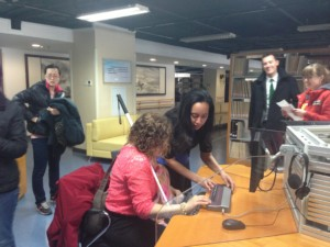 Haben and Tai use braille display at Library for the Blind