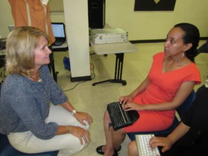 Haben explains assistive technology to senator Judy Buckley