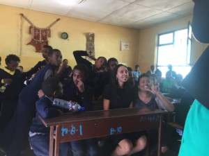 Haben sitting with the students at the Victory School for the Deaf.