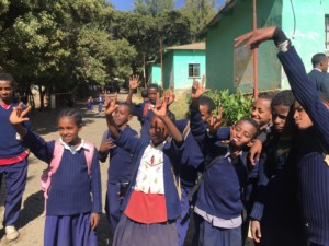 Children waving goodbye at deaf school