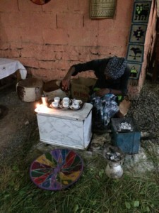 A woman prepares traditional Ethiopian coffee in Mekele.