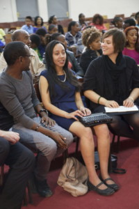 Haben reading braille at Addis University event.