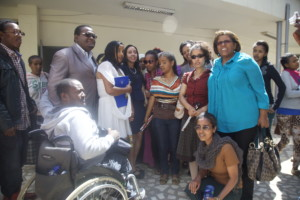 Haben and Aster posing with disabled students at Addis University.