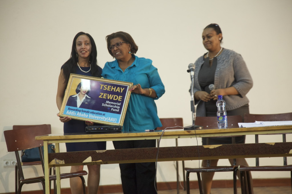 Haben and Aster posing with award at Addis University