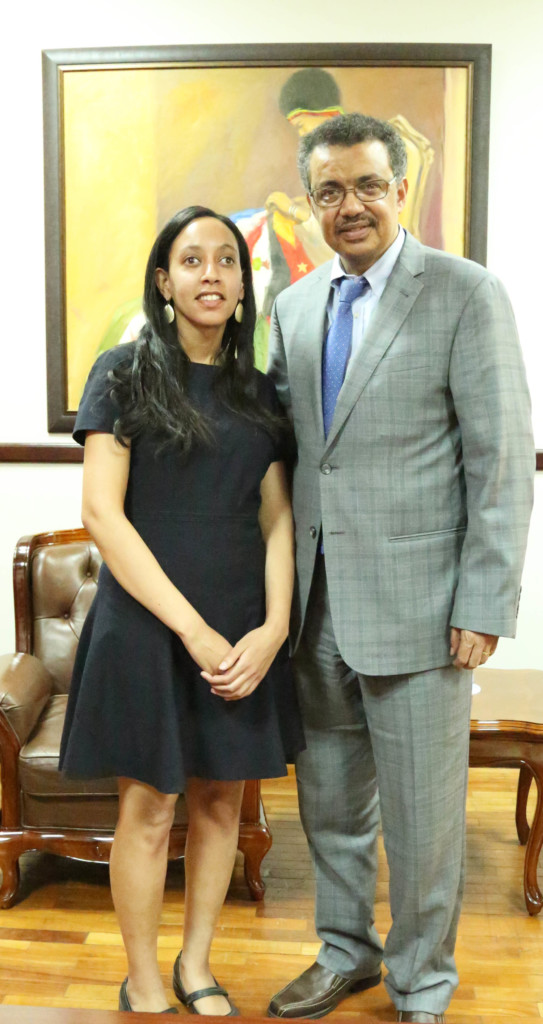 Haben and Dr. Tedros posing in front of painting at Ministry of Foreign Affairs.