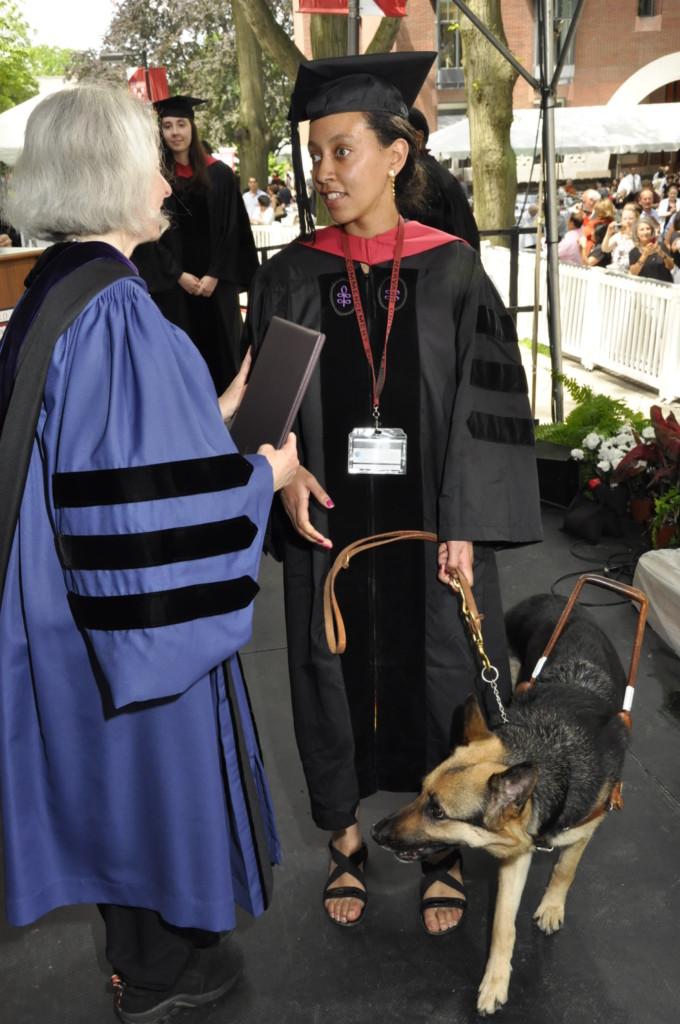Harvard Law School Dean Martha Minow hands Haben her diploma