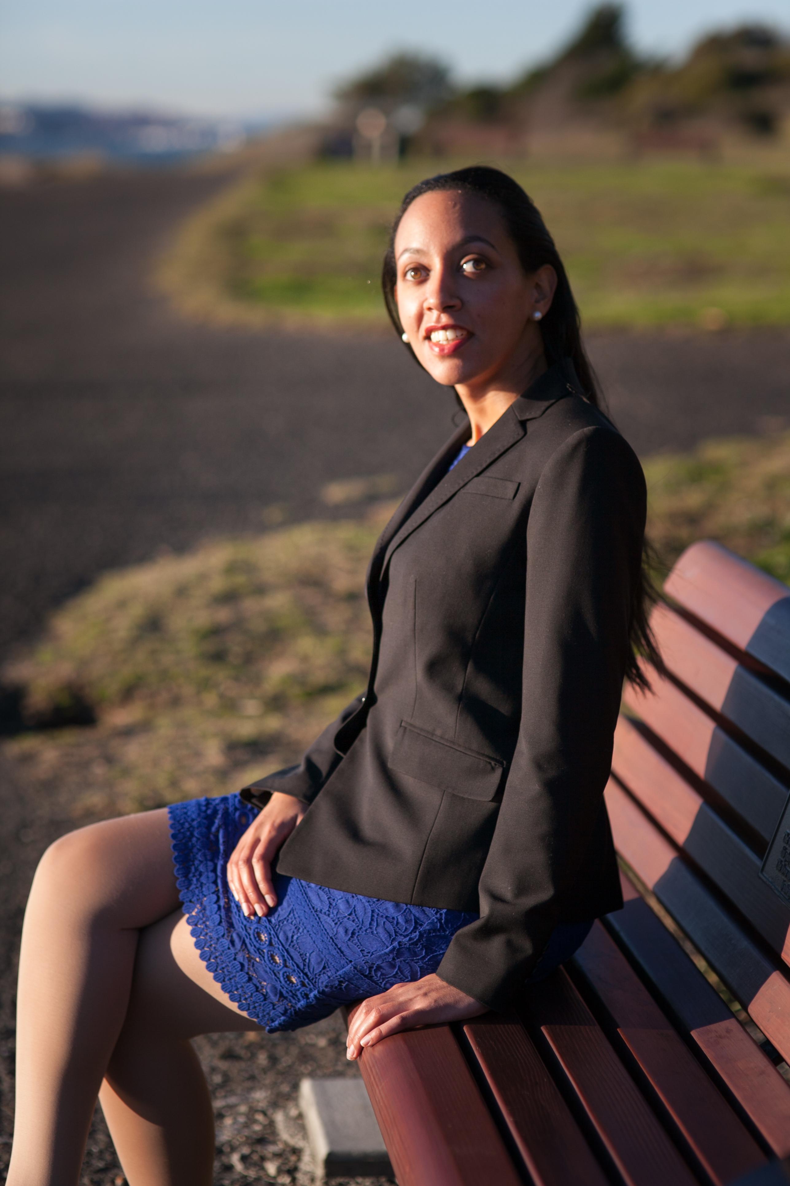 Haben sitting on a park bench at Berkeley Marina