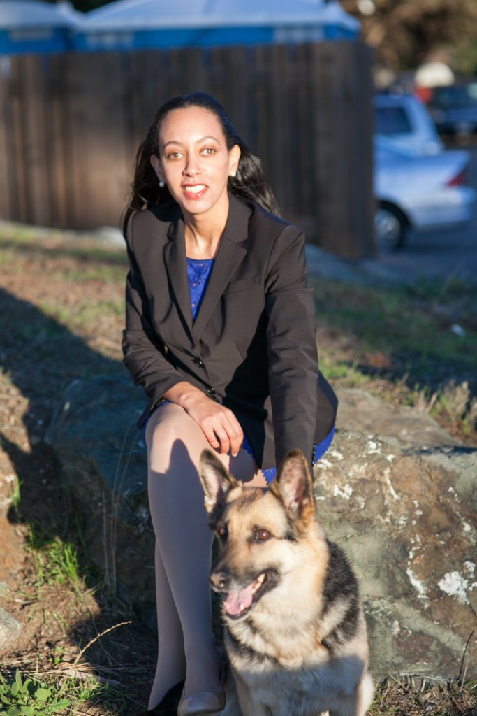 Haben and her German Shepherd Maxine sitting on a rock at Berkeley Marina