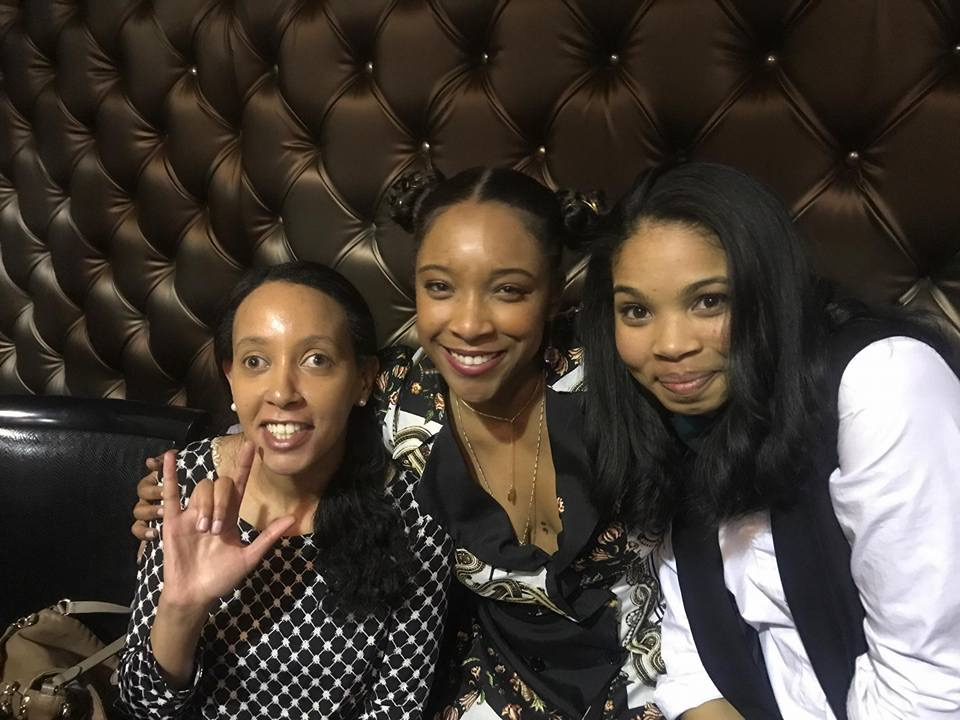 "Haben Girma, Treshelle Edmond, and Carmen LoBue are smiling and leaning in for the camera. Haben holds up the sign for ""I Love You"" in American Sign Language. Photo by Treshelle Edmond."