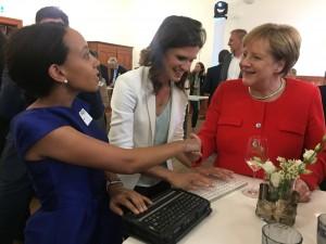 Chancellor Angela Merkel and Haben Girma