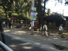 People walking down the street in downtown Addis.