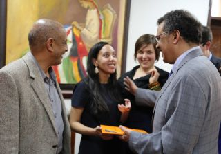 Dr. Tedros gives Haben a traditional scarf.