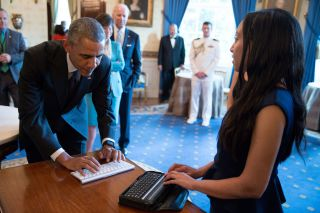 Haben talks with President Obama at the White House 25th Anniversary celebration of the ADA.