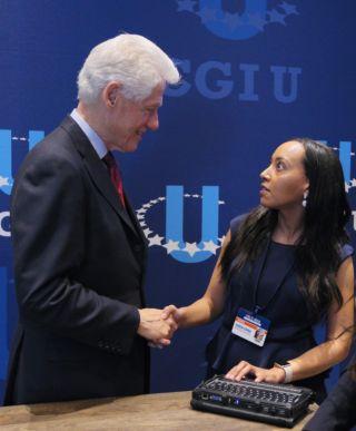 President Bill Clinton shakes hands with Haben Girma